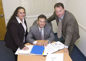 Secure in their roles as safeguards are Richard Wolfson (center), president of U.S. Security Care, Inc.; Christine Tumolo, operations manager; and Tom Owen, director of operations.